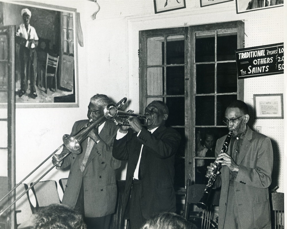 Louis Nelson, Punch Miller, and George Lewis playing on the Hall's bandstand (1964).